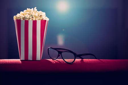 pop corn and 3d glasses on armchair cinemas