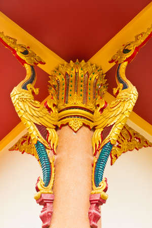 golden bird pattern decorative roof suspension of thai temple photo