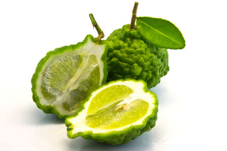 Pile green kaffir limes with for background