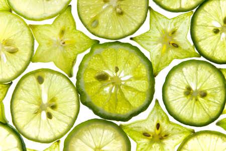 Slices of fresh fruit star with lemon isolated on white background Reklamní fotografie - 21226174
