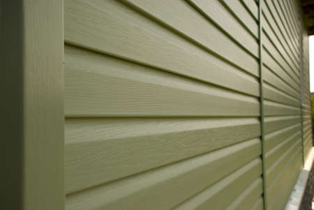 Siding wall of building in perspective closeup  in the daytime outdoors Stock Photo