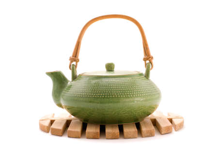 Green teapot on stand photo