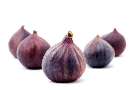 Five figs isolated on a white background Stock Photo