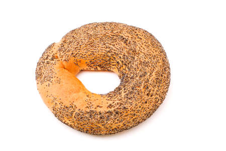 One bagel with poppy seeds  isolated on white