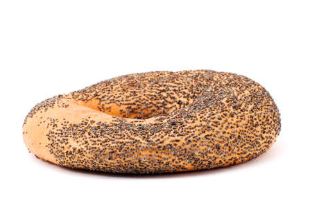 One bagel with poppy seeds on white Stock Photo