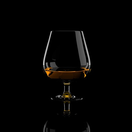 snifter: Snifter glass of cognac. Isolated on black background.