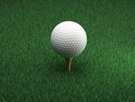 Golf ball in bright green grass photo