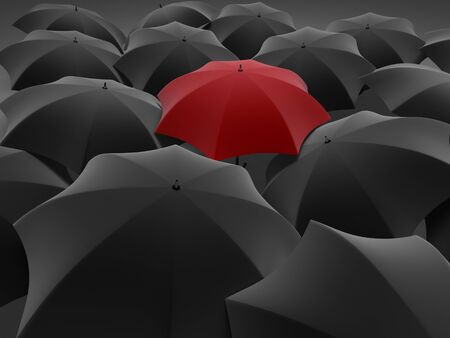 Many black umbrellas. One red unique umbrella. Stock Photo