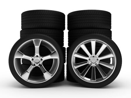 Different wheels with tires isolated on white background photo