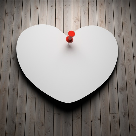 Blank paper heart on wood background