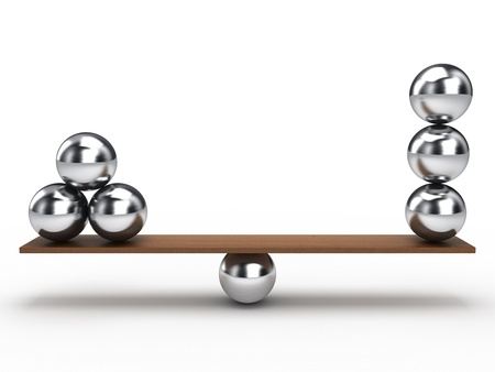 Équilibrage de boules sur planche de bois Banque d'images