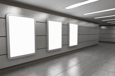 Blank advertising billboards in underground passage photo