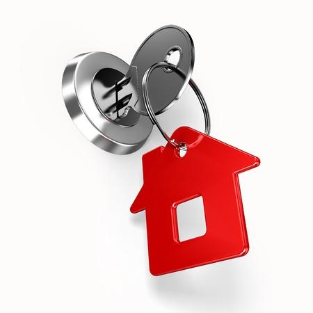 to lock: Clave de la casa con etiqueta Foto de archivo