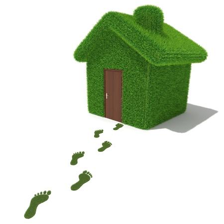 green footprint: Green grass house with grass footprints Stock Photo