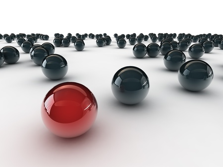 One unique red ball, among other black photo