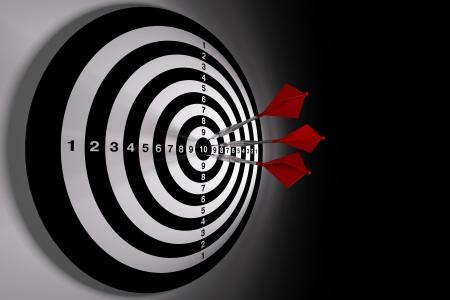 Darts hitting a target on black background Stock Photo - 10539392