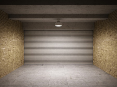 Empty garage with metal roll up door photo