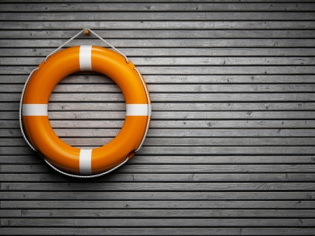 lifebuoy: Lifebuoy attached to a wooden wall