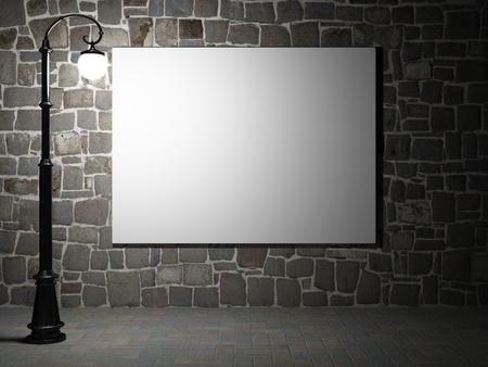 lampposts: Cartelera en blanco sobre una pared de ladrillo iluminada por farolas Foto de archivo