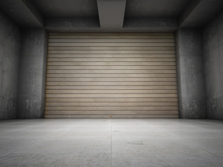 Empty garage with metallic roll up door photo