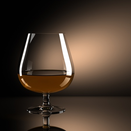 Glass of brandy with brown background photo