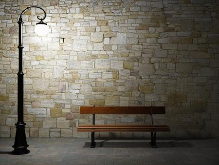 lampposts: Vista nocturna de la pared de ladrillo iluminadas con luz antigua calle de moda y un banco Foto de archivo