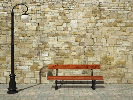 Brick wall with old fashioned street light and bench photo