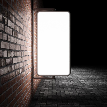 blank box: Blank street advertising billboard on brick wall at night Stock Photo