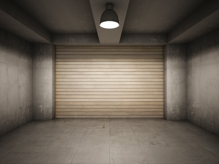 abandoned warehouse: Empty garage illuminated by lamp