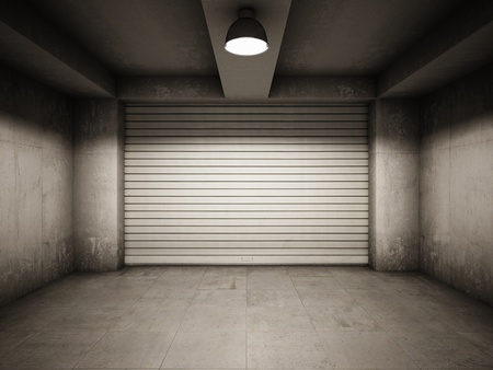 Empty garage illuminated by lamp