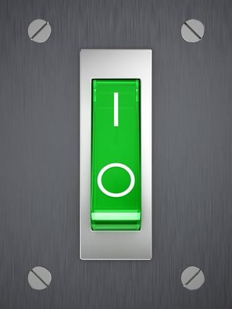 Green toggle switch on metallic surface photo