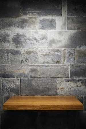 Illuminated empty shelf on brick wall Stock Photo - 11768312