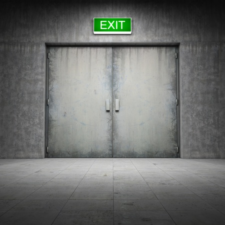 exit: Industrial building made of grungy concrete with exit door
