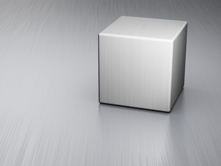 Metal cube on brushed steel plate photo
