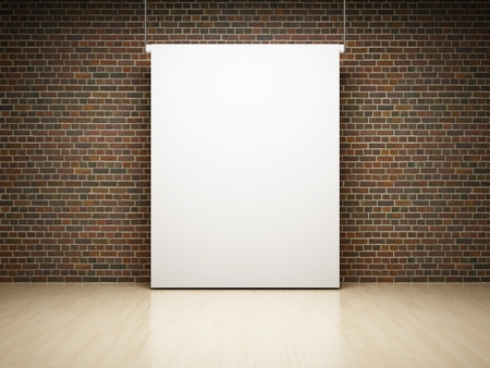 projections: Empty white projection screen in studio on brick wall Stock Photo