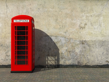 Classic red telephone booth at the dirty grunge wall photo