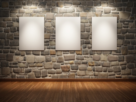 Blank frame on stone wall illuminated spotlights Stock Photo