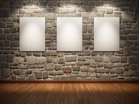 brick floor: Marco en blanco en la pared de piedra iluminada focos