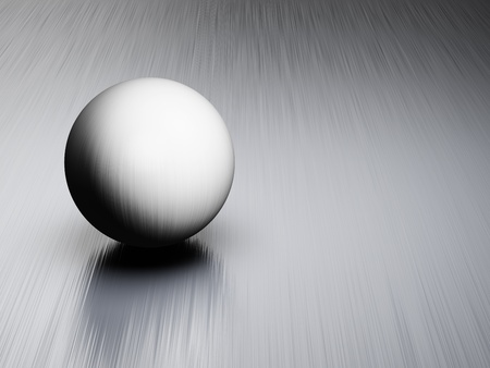 Metal ball on brushed steel plate Stock Photo - 14129790
