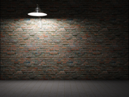 Dirty brick wall illuminated by lamp photo