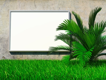 Blank advertising billboard on grunge wall with palm on grass photo