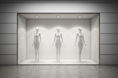 vitrine: Boutique display window with mannequins