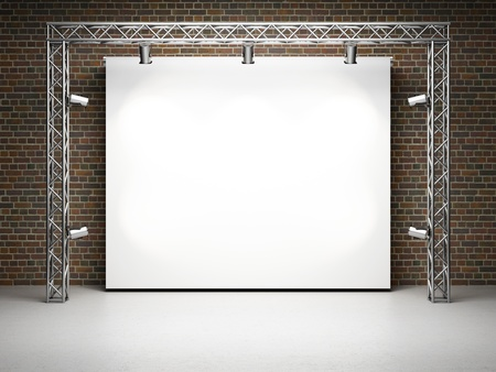 Blank trade exhibition stand with screen and spot lights on brick wall photo
