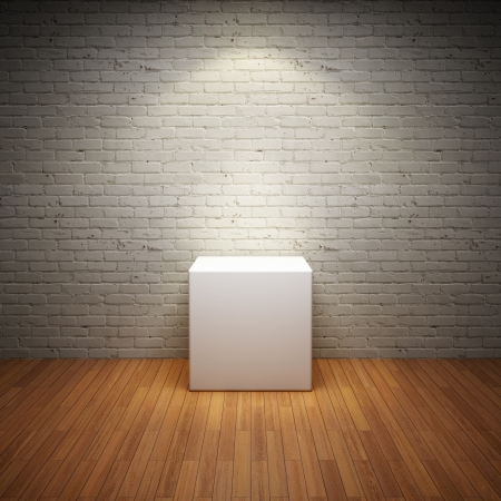 art gallery: Empty white stand in old interior room with brick wall and light spot Stock Photo
