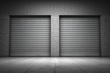 shutter door: Garage building made of concrete with roller shutter doors