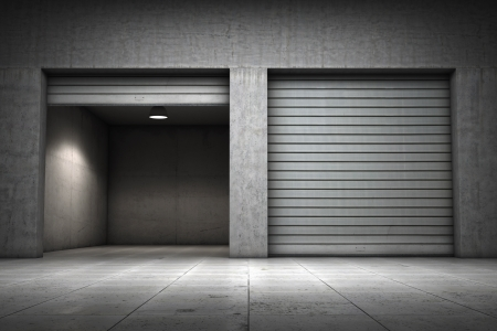 Garage building made of concrete with roller shutter doors photo