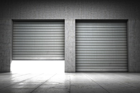 Garage building made ​​of concrete with roller shutter doors Stock Photo - 15089242
