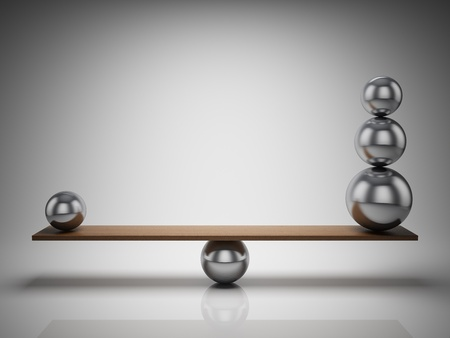 Balancing balls on wooden board photo