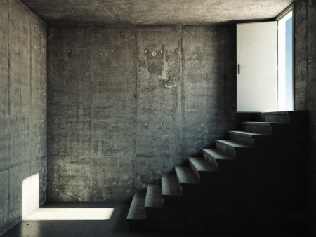 Interior room with concrete walls and stairs leading to the exit photo