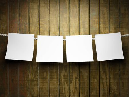 message board: Blank sticky notes hanging on a wooden wall Stock Photo